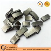 Zigzag diamond core drill bit segment for drilling reinforced concrete
